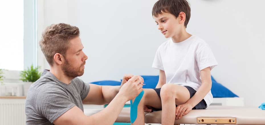 Child having physiotherapy on knee