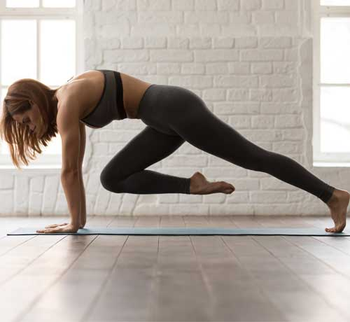 Woman Stretching leg on exercise mat