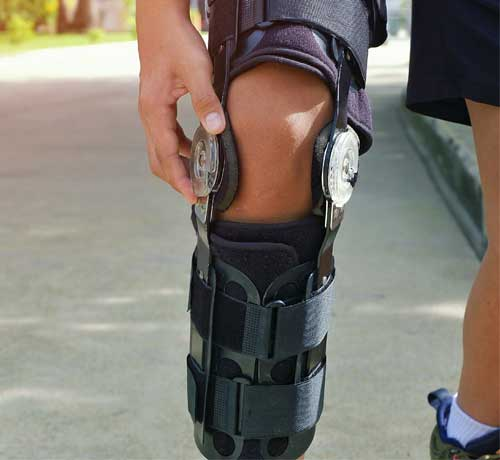 Person's leg with brace fitted in knee